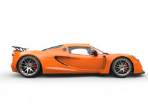 Orange sports supercar - side view Royalty Free Stock Images