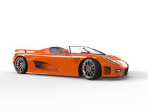 Orange sportscar with blue seats. Side view Stock Photos