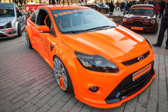 Orange sporty Ford focus car stands parked on the street Stock Photos