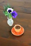 Orange spotty mug and anemones Stock Photo