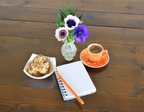 Orange spotty mug, cookies and note pad Stock Photo