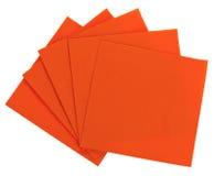 Orange square paper serviette (tissue). Isolated on white Royalty Free Stock Photo
