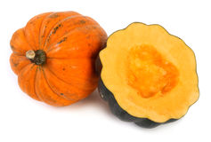Orange squash. Orange acorn squash over white background Royalty Free Stock Photos