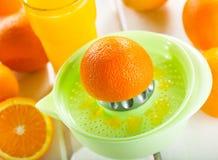 Orange squeezer with fresh fruits Stock Photos