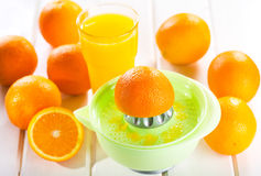 Orange squeezer with fresh fruits Royalty Free Stock Photos