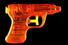 Orange Squirt Gun Stock Photos