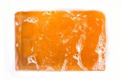 Orange stång av glycerintvål på vit bakgrund Royaltyfri Fotografi