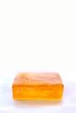 Orange stång av glycerintvål som isoleras på vit bakgrund Arkivfoton