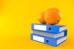 Orange with stack of ring binders. On orange background Royalty Free Stock Image