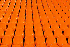 Orange stadium seats background Stock Images