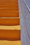 Orange stair and blue background Royalty Free Stock Photo