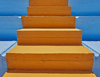 Orange stair and blue background Royalty Free Stock Image