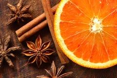 Orange, star anise and cinnamon. Orange with cinnamon sticks and star anise Royalty Free Stock Photo