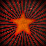 Orange star on grunge background Royalty Free Stock Images