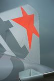 Orange star - logo Jetstar Pacific Airbus A320. Jetstar Pacific airplane on runway at Noi Bai airport in Hanoi, Vietnam -  aircraft rudder Royalty Free Stock Image