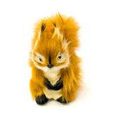 Orange statuette of a squirrel isolated on a white background Royalty Free Stock Images