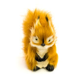 Orange statuette of a squirrel isolated on a white background Stock Images