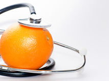 Orange with  stethoscope Royalty Free Stock Photo