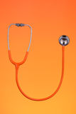 Orange stethoscope Stock Photos