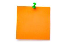 Orange sticker on green thumbtack. Placed on white background Royalty Free Stock Image