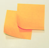 Orange Sticky Notes. Orange notice papers on the wall Royalty Free Stock Photo