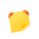 Orange sticky paper note with red clips Stock Image