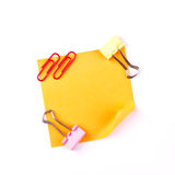 Orange sticky paper note with red clips Royalty Free Stock Photography