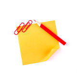 Orange sticky paper note with red clips and pencil Royalty Free Stock Photo