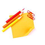 Orange sticky paper note with red clips and pencils Stock Photos