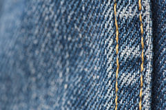 Orange stitch on the denim garment Stock Images