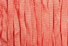 Orange stockinet ribbons background Stock Image