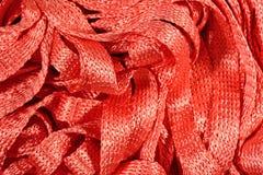 Orange stockinet ribbons background Stock Photos