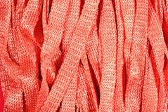 Orange stockinet ribbons background Royalty Free Stock Photos