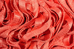 Orange stockinet ribbons background Royalty Free Stock Photo