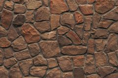 Free Orange Stone Wall. Bright Brown Rock Texture. Red Faceted Stone Wall Background For Design. Modern Architecture, Granite Structure Stock Photos - 148269723