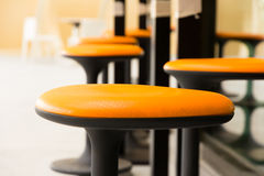 Orange stool. On a place Stock Photography