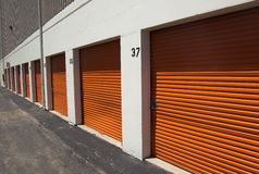 Orange storage garage doors. A raw of orange storage garage doors royalty free stock image