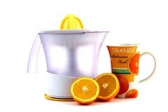 Orange with strainer isolated on white Royalty Free Stock Photo