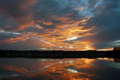 Orange stratocumulus cloudy coastal Sunrise Seascape. Australia stock images