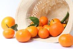 Orange and straw hat Royalty Free Stock Photos