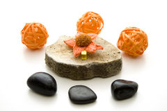 Orange straw sphere on stone Stock Images