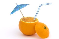 Orange with straw and umbrella over white. Orange with straw and blue umbrella on a white background Royalty Free Stock Photo