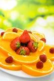 Orange, strawberry and raspberry Stock Images
