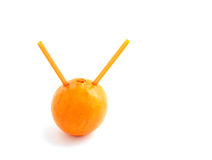 Orange with straws Royalty Free Stock Photo