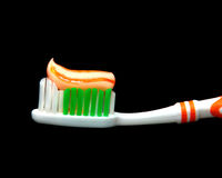 Orange Stripe. Matching tooth paste and tooth brush Royalty Free Stock Photography