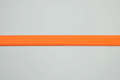 Orange stripe from artificial leather placed in horizontal position Stock Photo