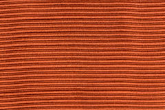 Orange striped fabric. Closeup detail of orange striped fabric as background Stock Photos