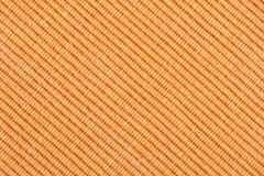 Orange striped fabric background. Orange striped fabric as background Stock Photo