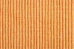 Orange striped fabric background Royalty Free Stock Images