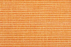 Orange striped fabric background Stock Photography
